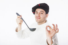 Chef on white. Chef holding ladle isolated on white stock photos
