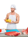 Chef in a white apron holding bananas Stock Images