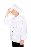 Chef in white hat with approval gesture Royalty Free Stock Photography