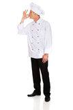 Chef in white hat with approval gesture Royalty Free Stock Photos