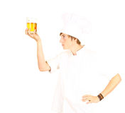 Chef in white uniform with beer Royalty Free Stock Photography
