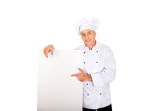Chef in white uniform holding empty banner Stock Images