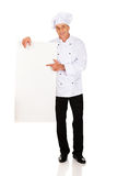 Chef in white uniform holding empty banner Royalty Free Stock Photos