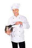 Chef in white uniform mixing his soup Royalty Free Stock Image