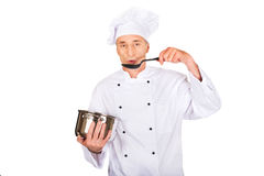 Chef in white uniform tasting his soup Royalty Free Stock Images