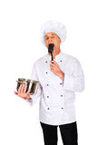 Chef in white uniform tasting his soup Royalty Free Stock Image
