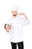 Chef in white uniform tasting his soup Royalty Free Stock Photo
