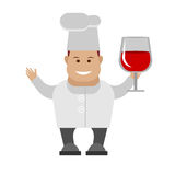 Сhef holding a glass of red wine Royalty Free Stock Photo
