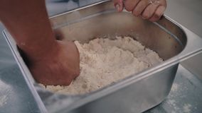 Chef wipes in the dough. In the kitchen stock footage