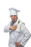 Chef wiping spoon on the towel. On a white background Royalty Free Stock Image