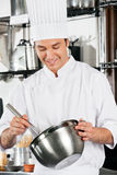 Chef With Wire Whisk And Mixing Bowl Stock Image