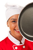 Chef woman behind frying pan Stock Image
