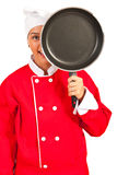 Chef woman behind frying pan Royalty Free Stock Image