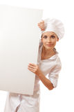 Chef woman with blank board in front of her Stock Photography