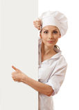 Chef woman with blank board in front of her Royalty Free Stock Photo