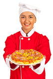 Chef woman giving pizza Royalty Free Stock Photos