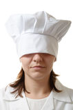Chef woman hiding her eyes. Under her hat Royalty Free Stock Photography