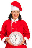 Chef woman holding big clock Royalty Free Stock Photography