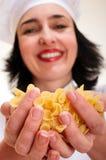 Chef woman holding macaroni handful Stock Photos