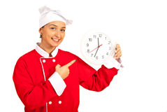 Chef woman indicate to clock Royalty Free Stock Images