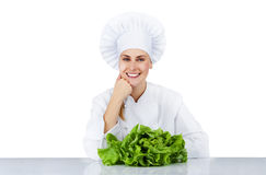 Chef woman. Isolated over white background by the table with sal Stock Images