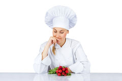 Chef woman. Isolated over white background by the table with veg Stock Image