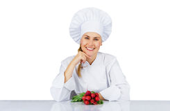 Chef woman. Isolated over white background by the table with veg Royalty Free Stock Photography