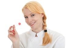 Chef woman with lollipop Stock Photos
