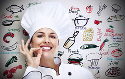 Chef woman. Over gray background Royalty Free Stock Photos