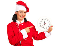 Chef woman pointing to clock Royalty Free Stock Photo