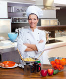 Chef woman portrait in the kitchen Royalty Free Stock Photography