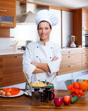 Chef woman portrait in the kitchen. Chef woman portrait with white uniform in the kitchen Royalty Free Stock Images
