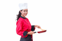 Chef woman in red uniform holding cooking utensils Stock Photos