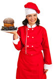 Chef woman serving sponge cake Royalty Free Stock Images