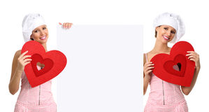 Chef woman showing billboard with heart shape royalty free stock photo
