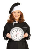 Chef woman showing clock Stock Image