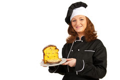 Chef woman showing plate with cake Stock Image