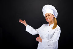 Chef woman showing somthing by hands Royalty Free Stock Photo