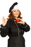 Chef woman showing tomato Stock Photography