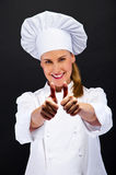 Chef woman shows ok sign over dark background Royalty Free Stock Images