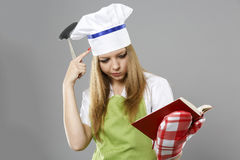 Chef woman thinking about what to cook Royalty Free Stock Photos