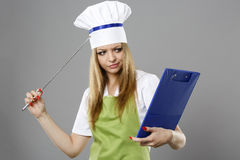 Chef woman thinking about what to cook Royalty Free Stock Images