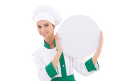 Chef woman in uniform holding big  empty plate with copy space i Stock Photos
