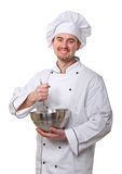 Chef at work. Caucasian young chef on duty stock image
