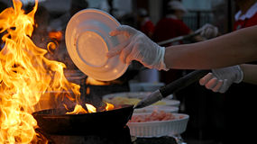 Chef at work - Flambe cooking Royalty Free Stock Photos