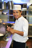 Chef at work with thumb up Stock Photo