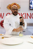 Chef working with immersion blender at Golosaria 2013 in Milan, Italy Stock Photo