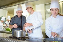 Chef working with trainees stock photo
