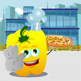 Chef yellow bell pepper with pizza holding a stop sign in the city Royalty Free Stock Photo