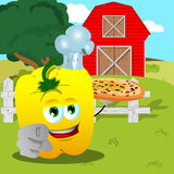 Chef yellow bell pepper with pizza pointing at viewer on a farm Stock Photos